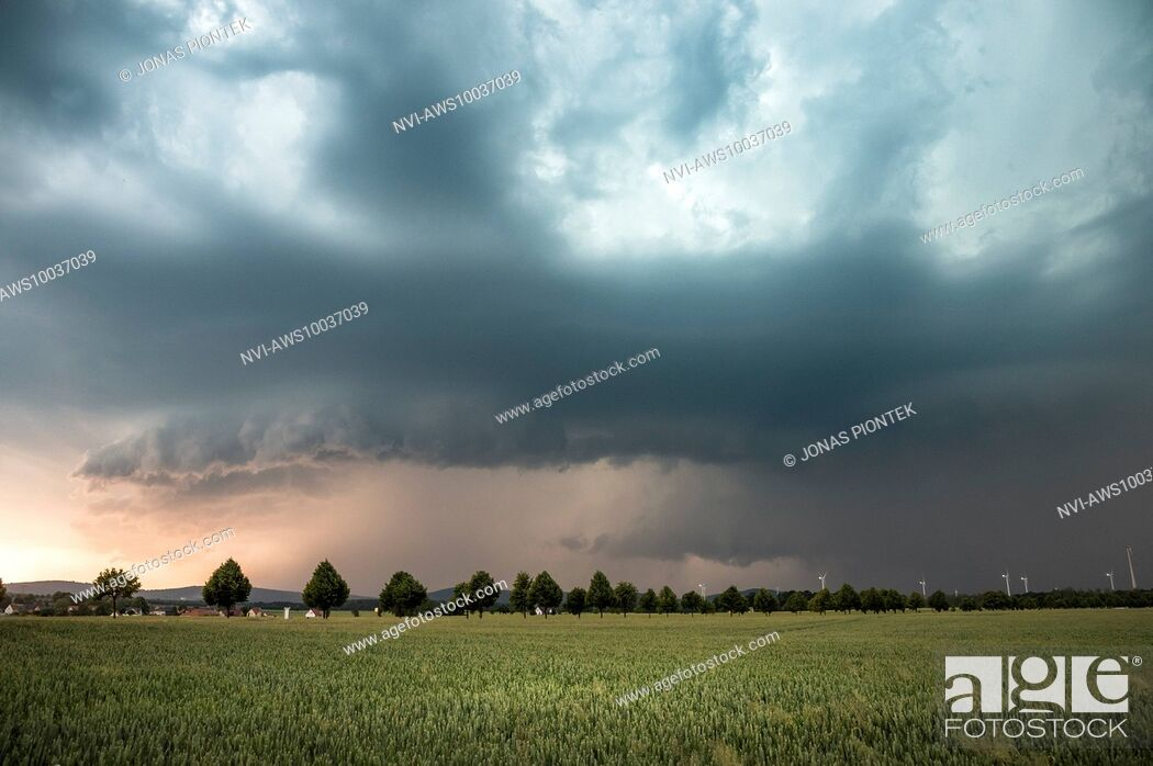 Stock Photo: Outflow dominant HP supercell with gust front and wall cloud in the light of the setting sun near Kamenz, Saxony, Germany.