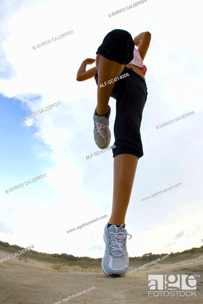 Stock Photo: Young woman exercising.