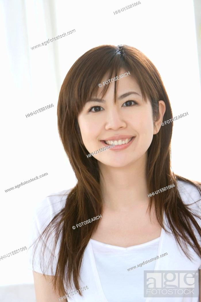 Stock Photo: Young woman, smiling, front view.