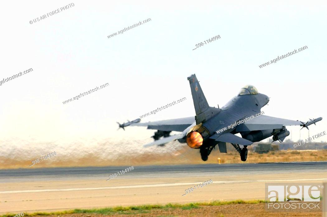 An F-16 Fighting Falcon from Hill Air Force Base, Utah, takes off
