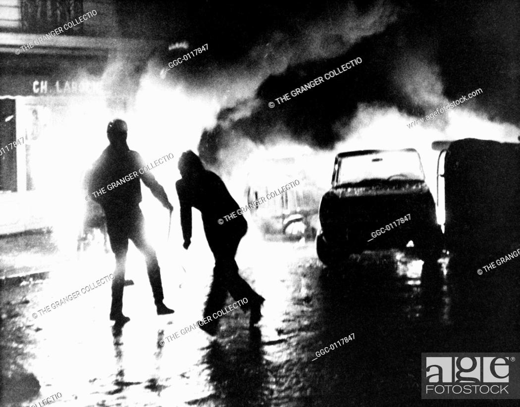 Stock Photo: PARIS STUDENT REVOLT, 1968.A barricade of burning cars put up by students in the Latin Quarter of Paris, France, 11 May 1968.