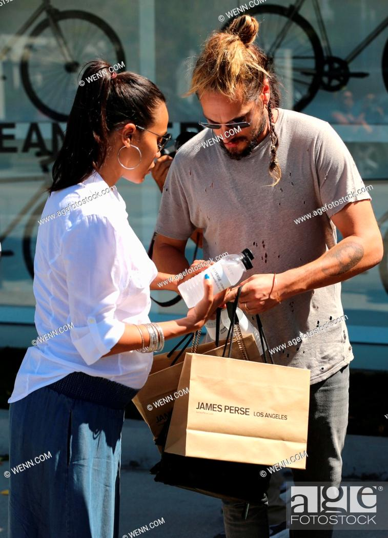 Zoe Saldana And Her Husband Marco Perego Exit The James