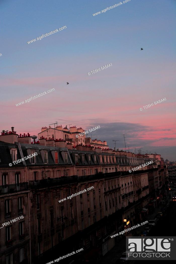 Stock Photo: Rows of buildings glowing at dawn.