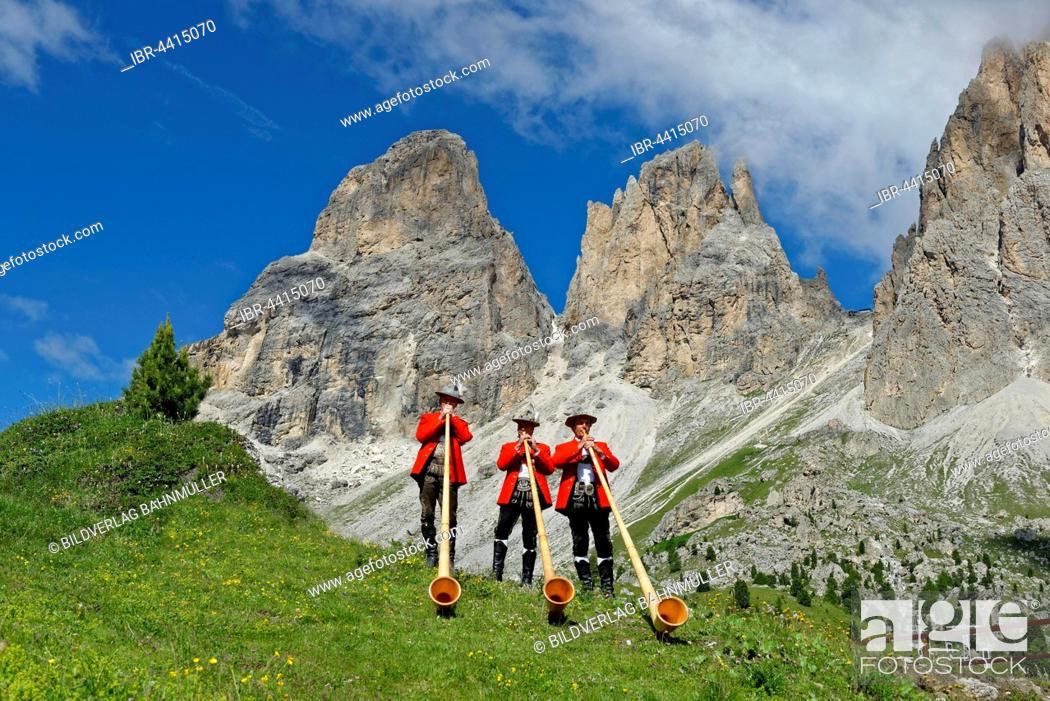 Stock Photo: Alphorn players in front of mountains Langkofel and Plattkofel, local costume group, Fest zur ladinischen Einheit 1946, Sella, Dolomites, South Tyrol, Italy.