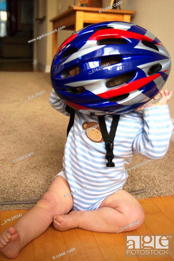 Stock Photo: baby with bike helmet.