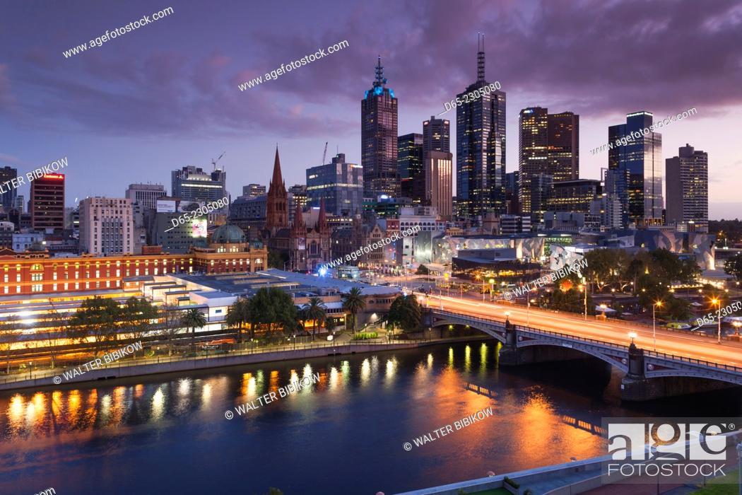 Stock Photo: Australia, Victoria, VIC, Melbourne, skyline with Yarra River and Princess Bridge, elevated view, dusk.