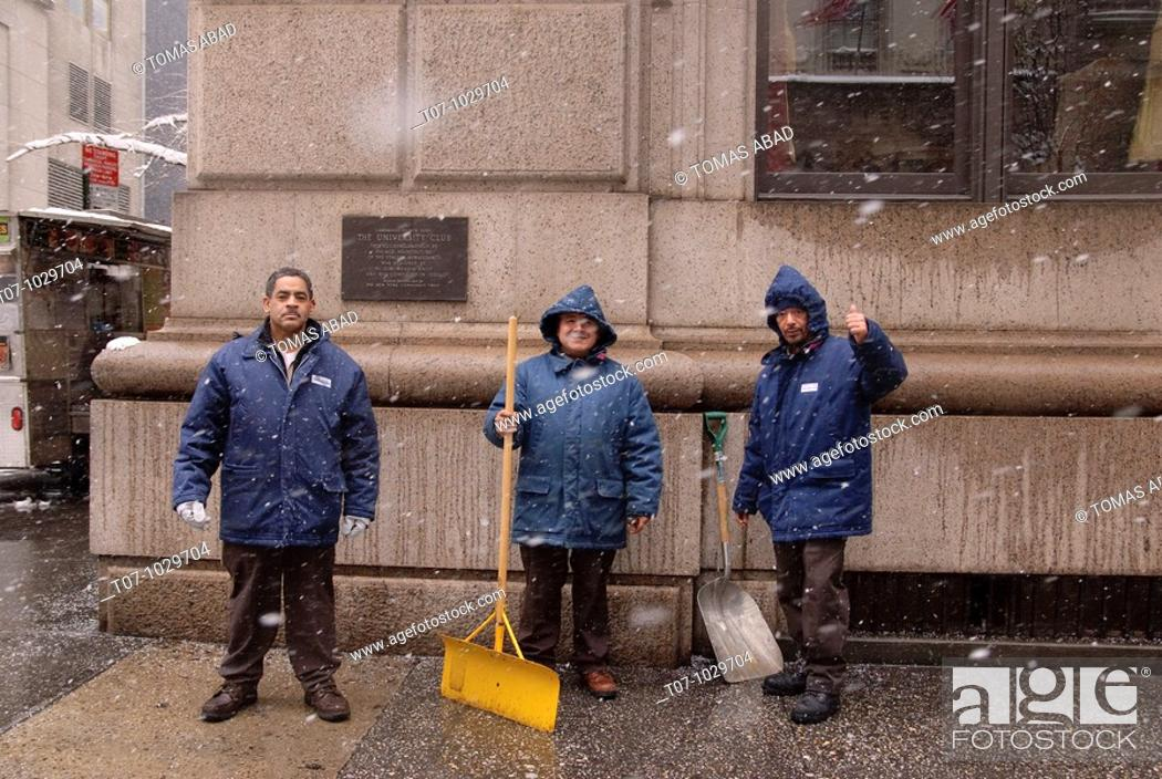 Stock Photo: Maintenance workers pose for a photograph outside The University Club of New York, an Architectural Landmark, 5Th Avenue.