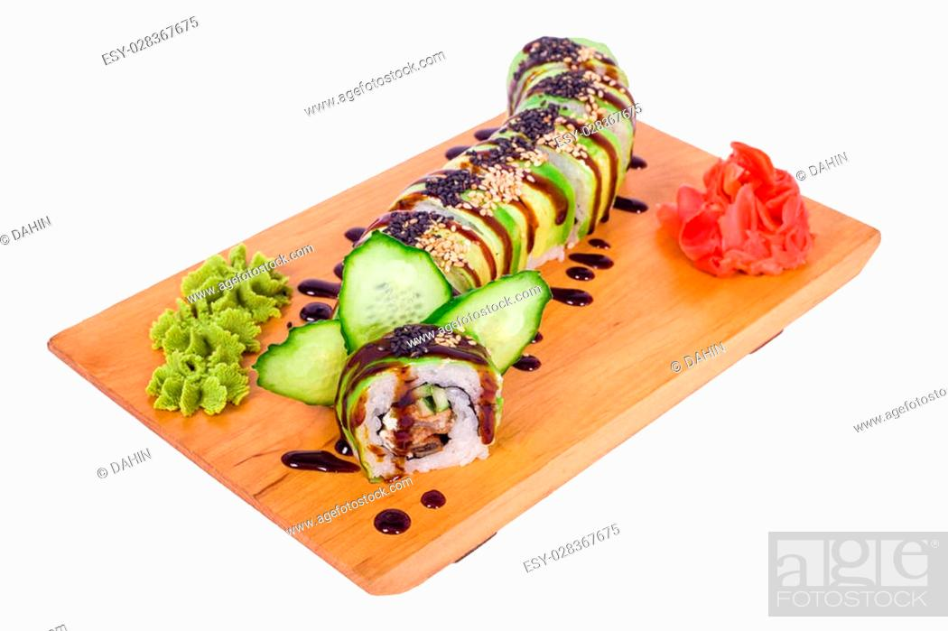 Imagen: delicious sushi with red caviar and wasabi on a wooden tray.