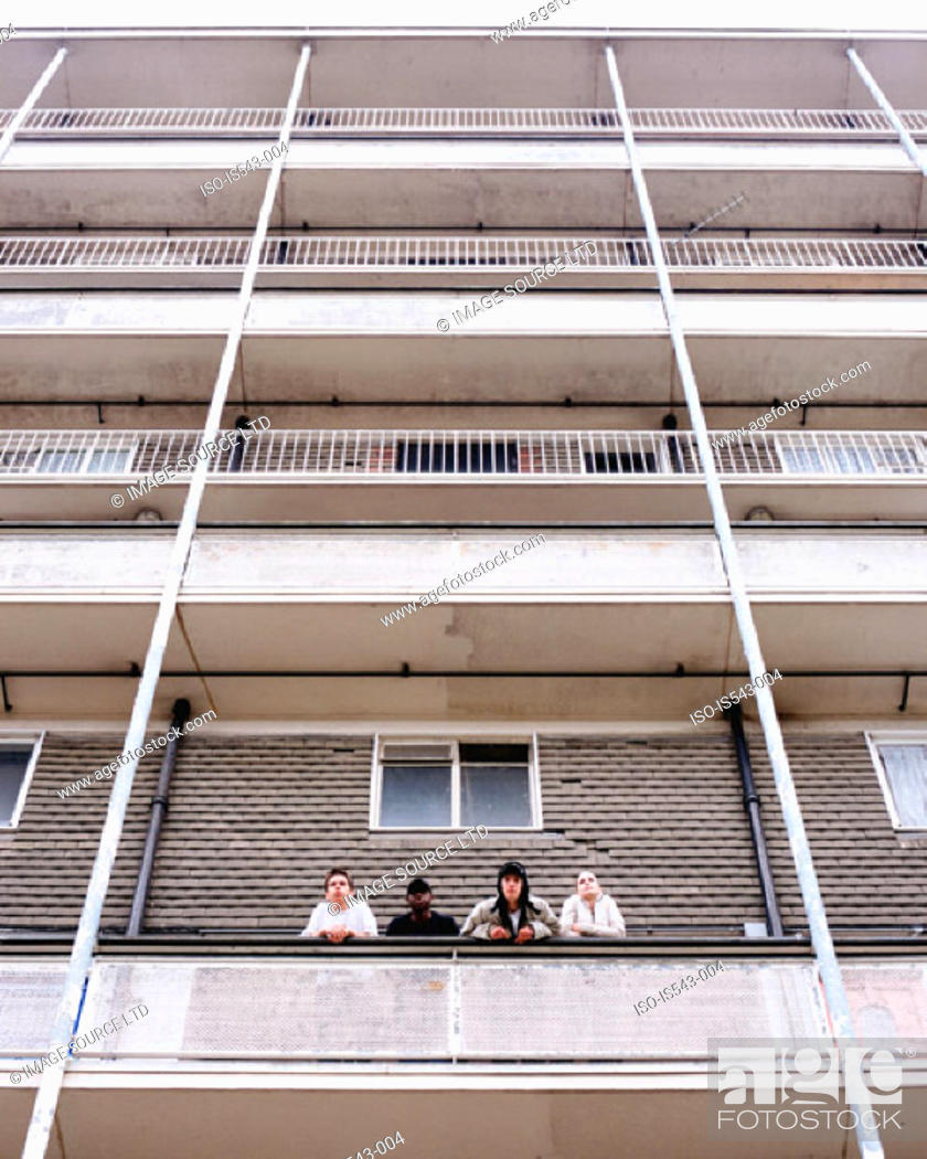 Stock Photo: Teenagers standing on balcony.
