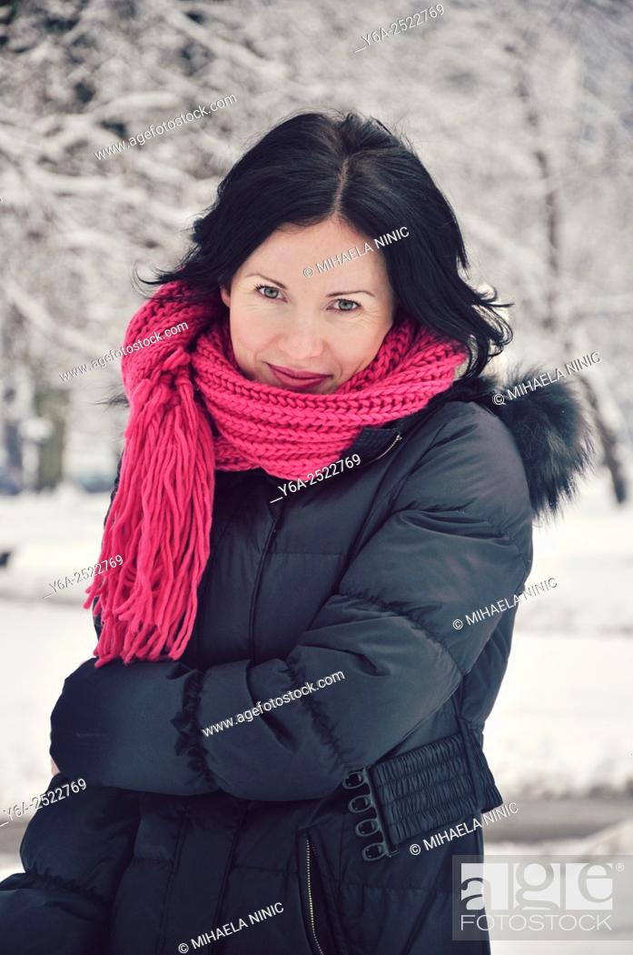 Stock Photo: Smiling mid adult woman portrait, winter.
