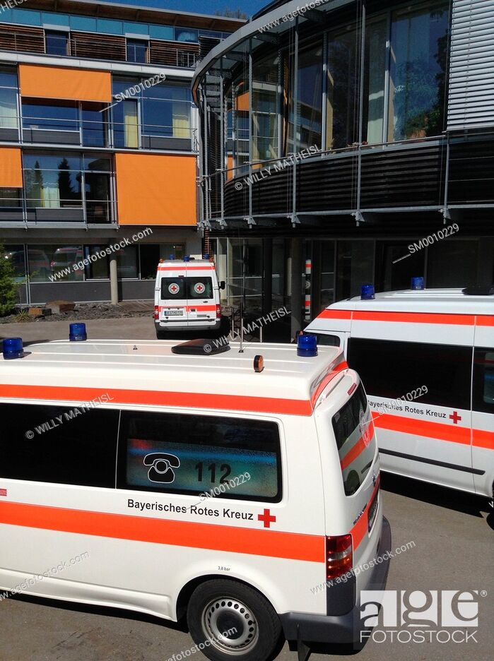Stock Photo: Bavarian Ambulance in front of Hospital, Germany.
