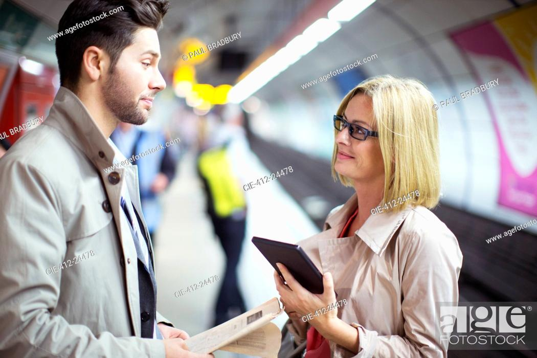 Stock Photo: Business people talking in subway station.
