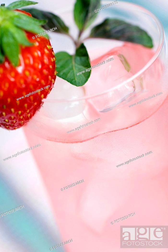 Stock Photo: Herb tea with strawberry garnish.