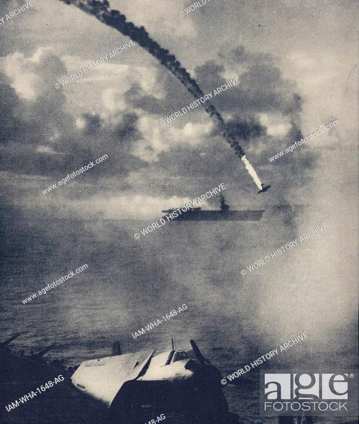 Japanese Kamikaze or suicide pilot drives his aircraft into an