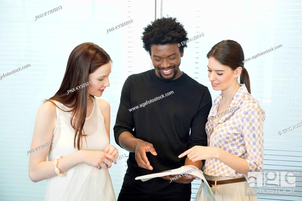Stock Photo: Business executives discussing documents in an office.