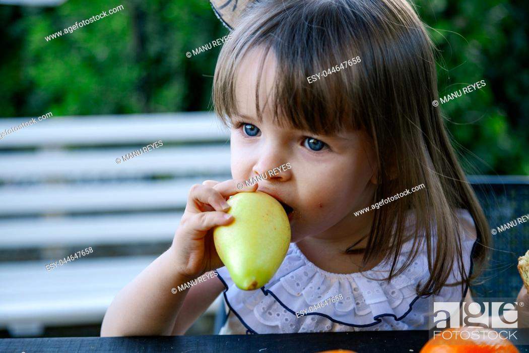 Stock Photo: Children playing outdoors with different fruits. Madrid, Spain.