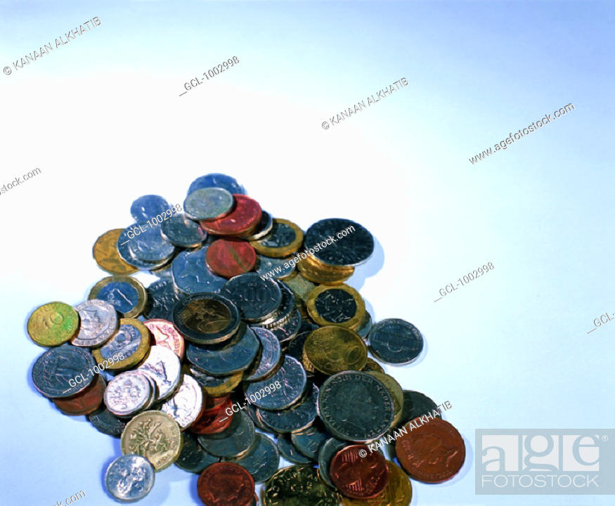 Stock Photo: Pile of coins of various international currencies.