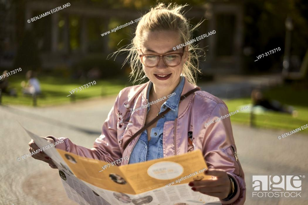 Stock Photo: Woman with city guide map, in Berlin, Germany.