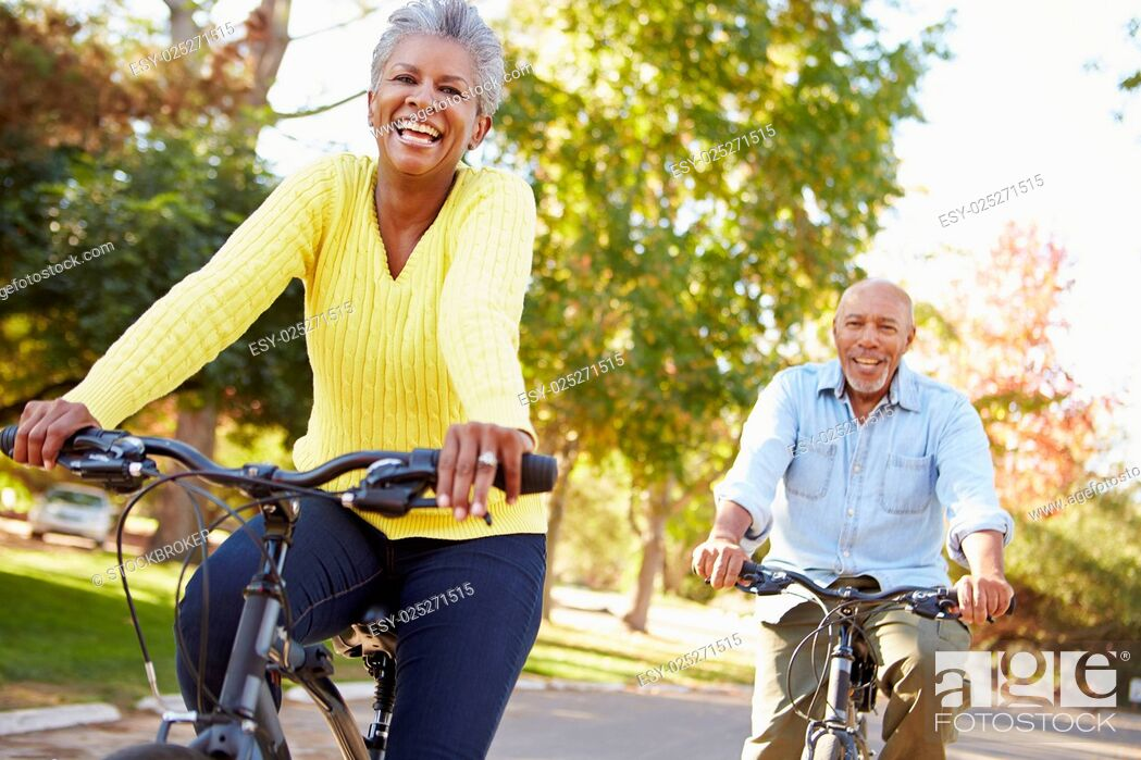 Stock Photo: Senior Couple On Cycle Ride In Countryside.