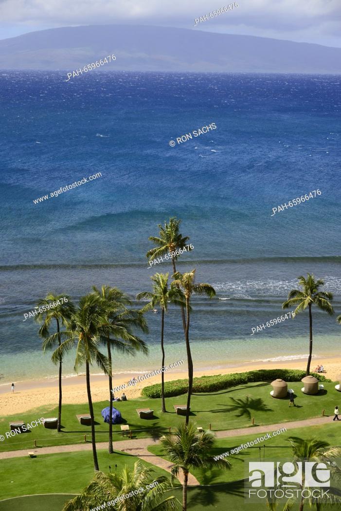 Stock Photo: View looking west towards Lanai, one of the Hawaiian Islands, from Kaanapali Beach, Maui, Hawaii on Wednesday, February 17, 2016.