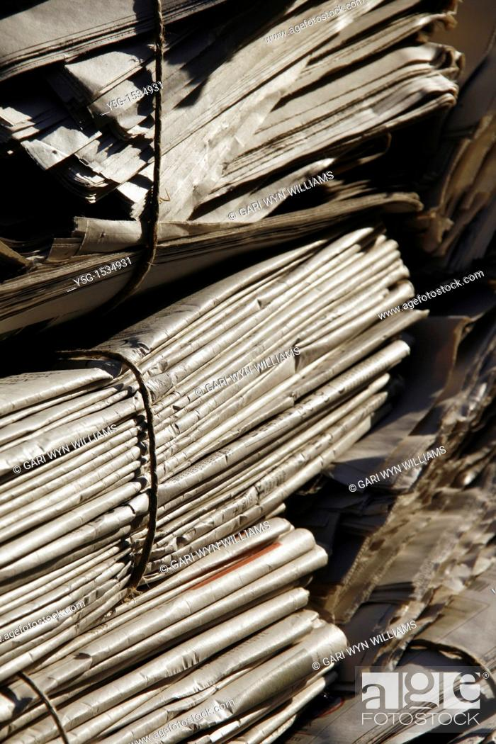 Stock Photo: pile of old used newspapers left in street road in city town.