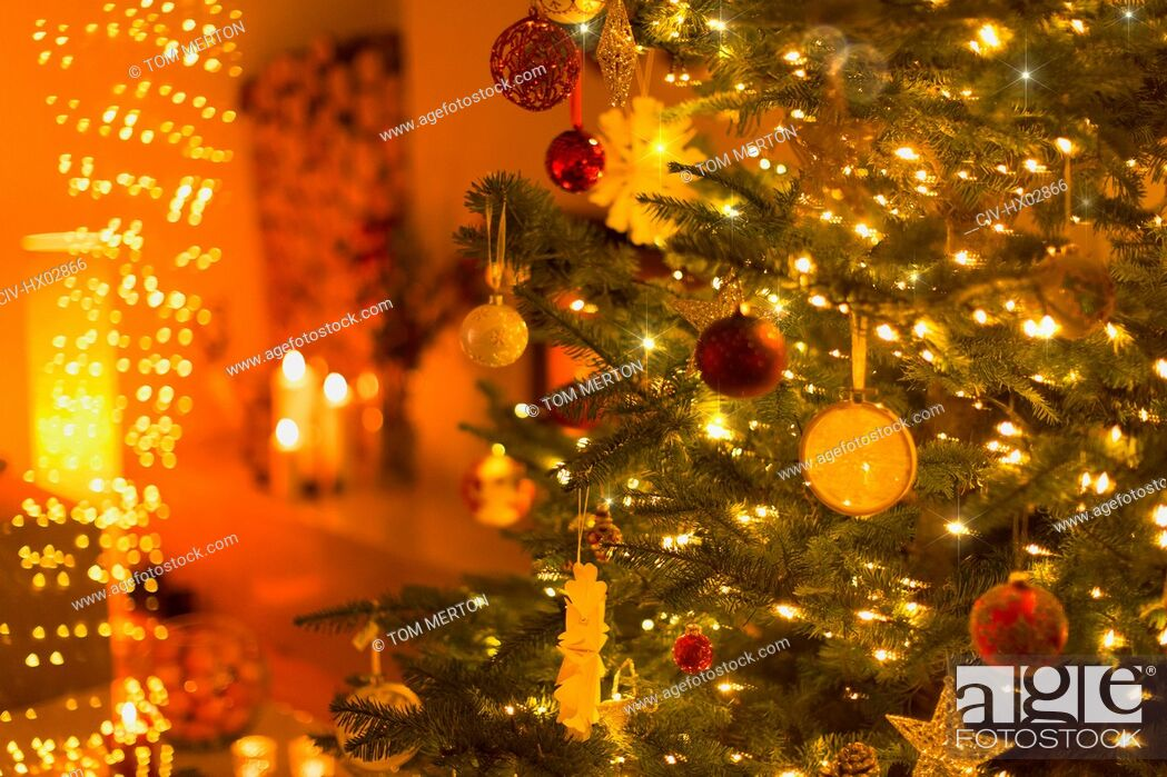 Stock Photo: Ornaments and string lights on Christmas tree.