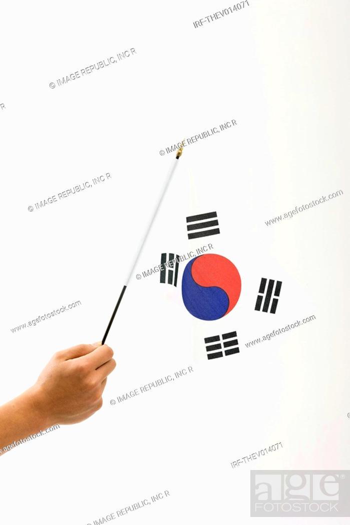 Stock Photo: right hand holing Korean flag, Taegeukgi.