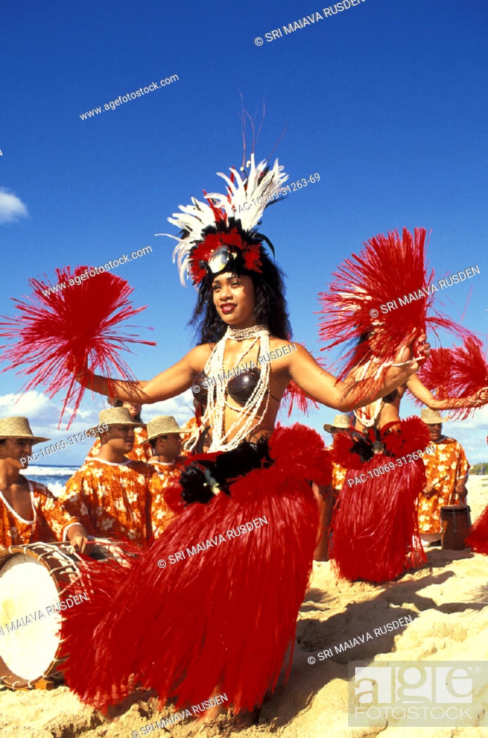 Stock Photo: Tahitian dancers performing with Tahitian drummers on beach.
