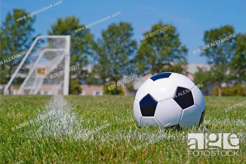 Stock Photo: Soccer ball in corner kick area.
