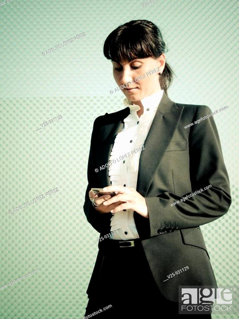 Photo de stock: Businesswoman looking at cell phone.