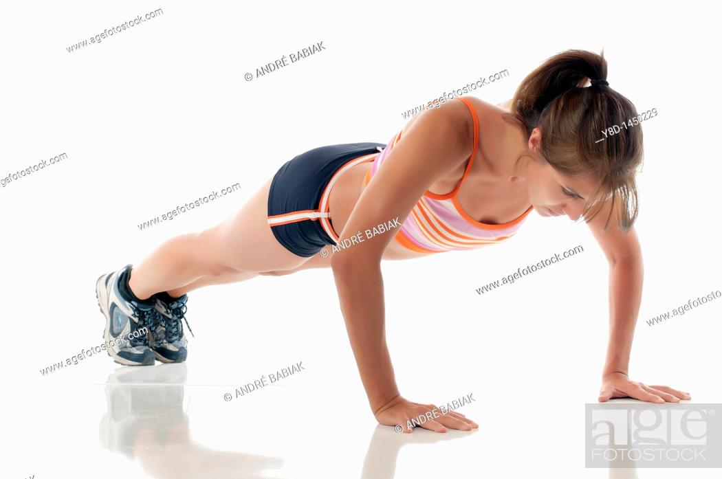 Stock Photo: Hispanic fitness woman exercising - Working out by doing push ups.