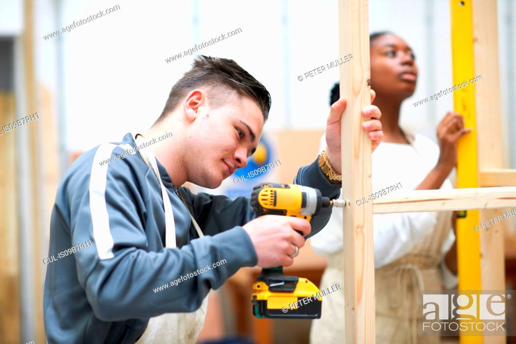 Stock Photo: Student learning how to do building work.