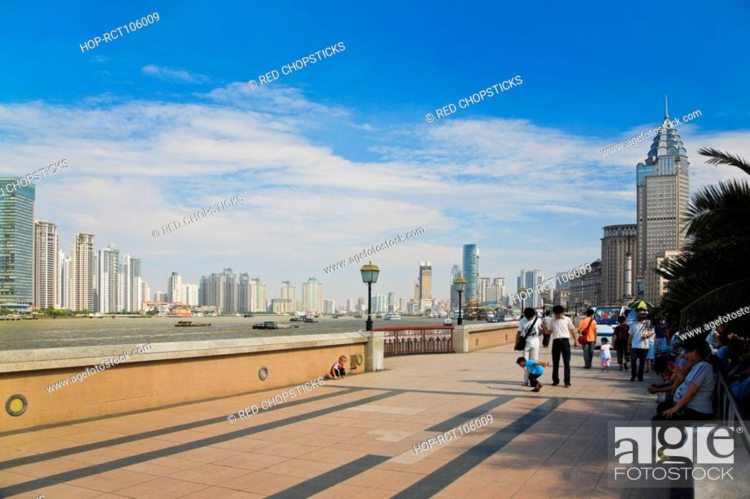 Stock Photo: Group of people walking on the road, Lujiazui, The Bund, Shanghai, China.