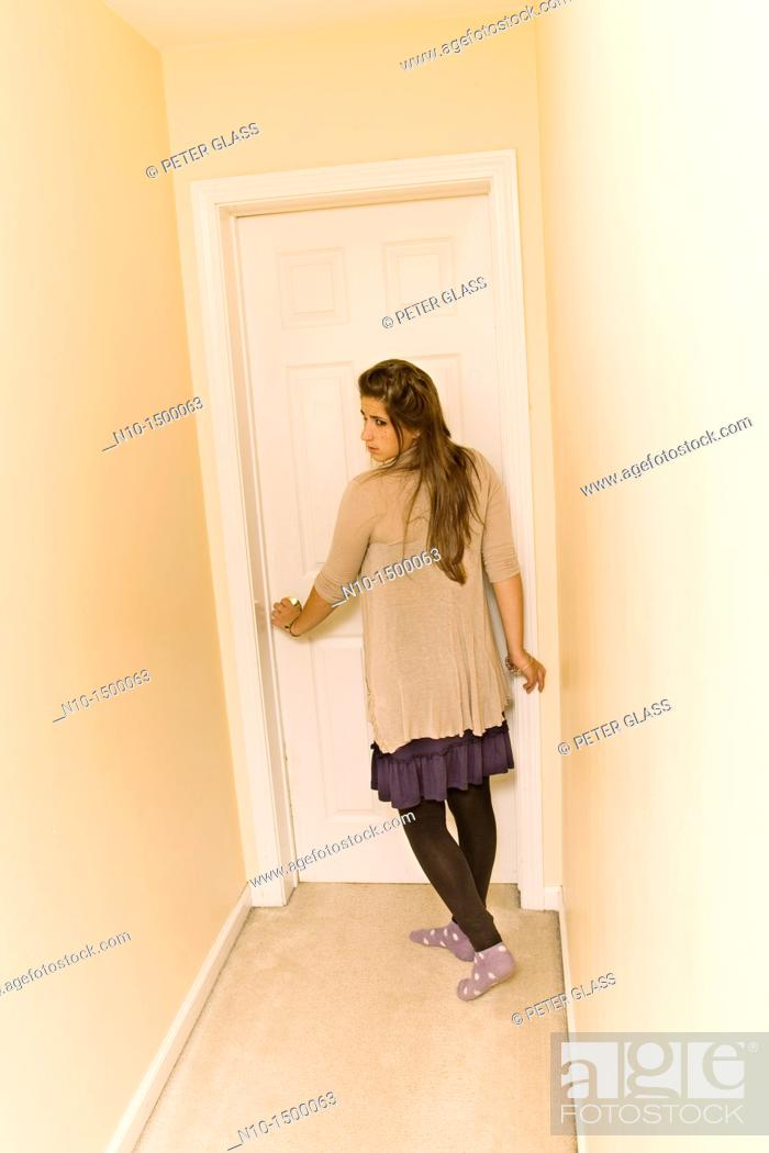 Stock Photo: Teen girl in the hallway of her house.
