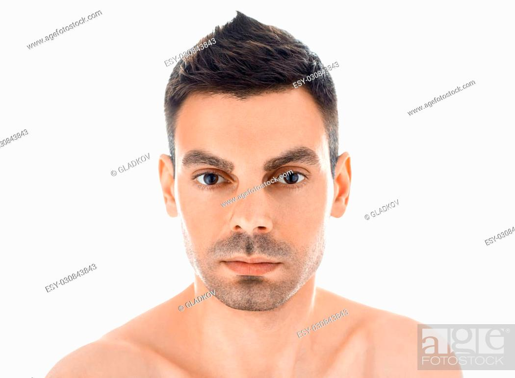 Stock Photo: Closeup portrait of young handsome man with healthy clean skin isolated on white background.