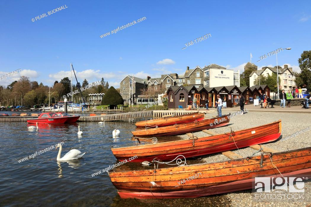Stock Photo: Bowness on Wndermere, Cumbria, England, UK, Europe  Wooden rowing boats for hire on Windermere lakeside in the Lake District National Park.