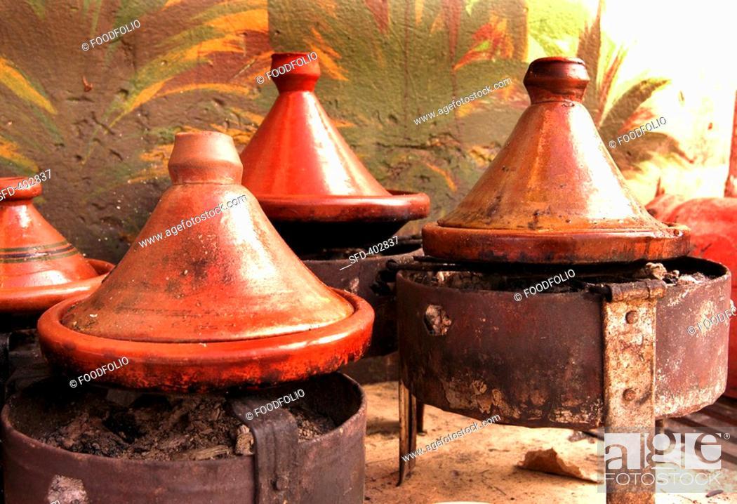 Stock Photo: Tajines on charcoal burners.