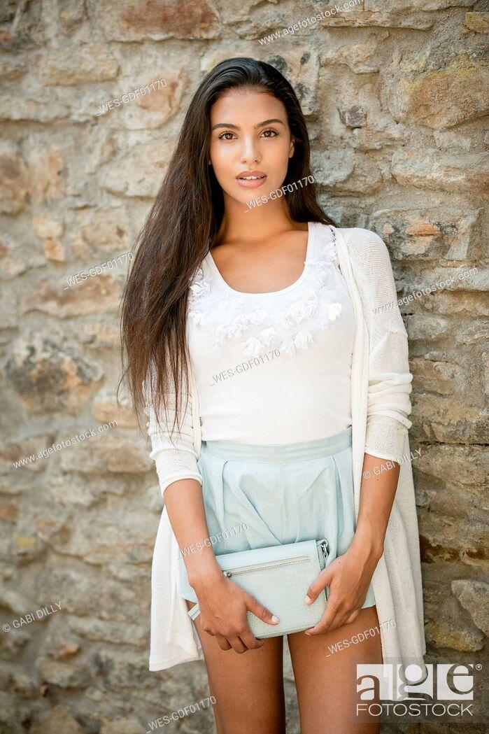 Stock Photo: Portrait of fashionable young woman with handbag.