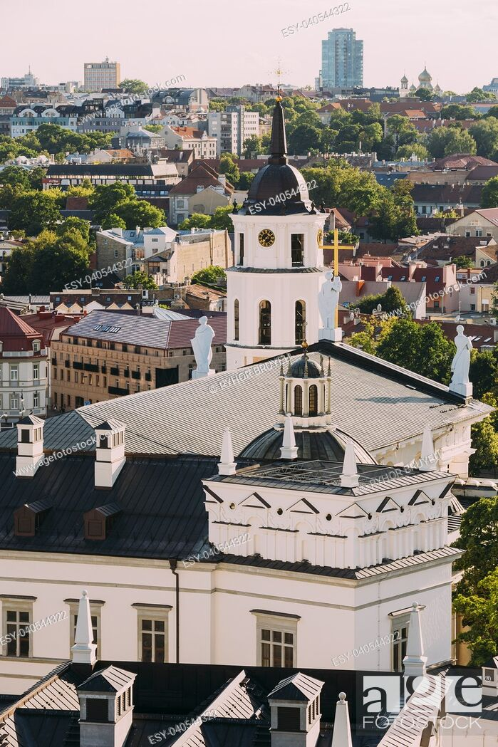 Stock Photo: Vilnius, Lithuania. View Of Bell Tower Chapel, Angels On Roof Of Cathedral Basilica Of St. Stanislaus And St. Vladislav And Palace Of Grand Dukes Of Lithuania.