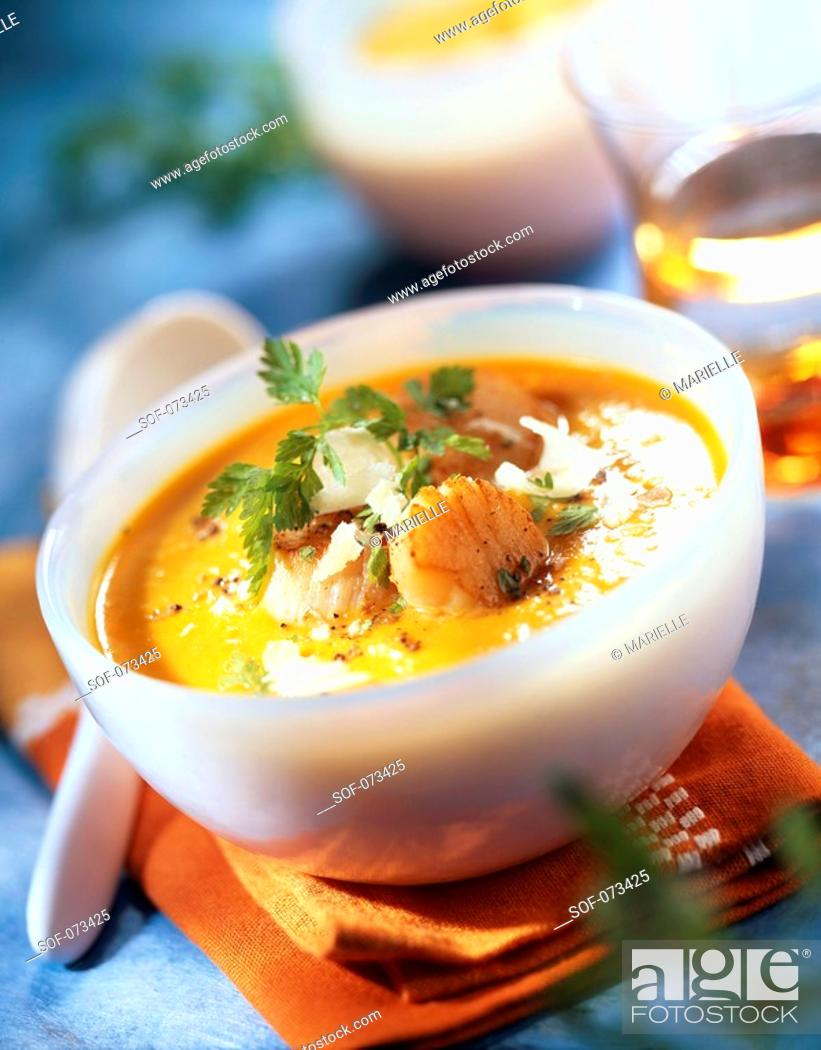 Stock Photo: creamed pumpkin soup with scallops.
