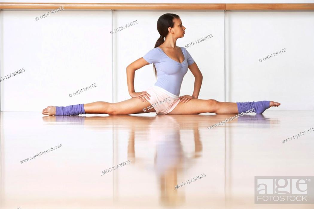 Stock Photo: Dancer Stretching on floor.