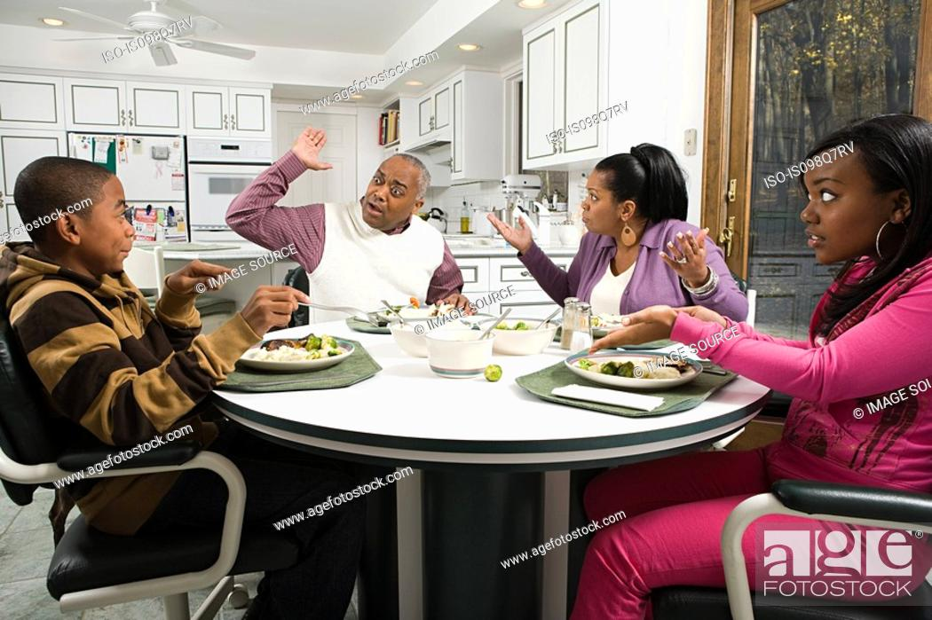 Stock Photo: Family argument at the dinner table.