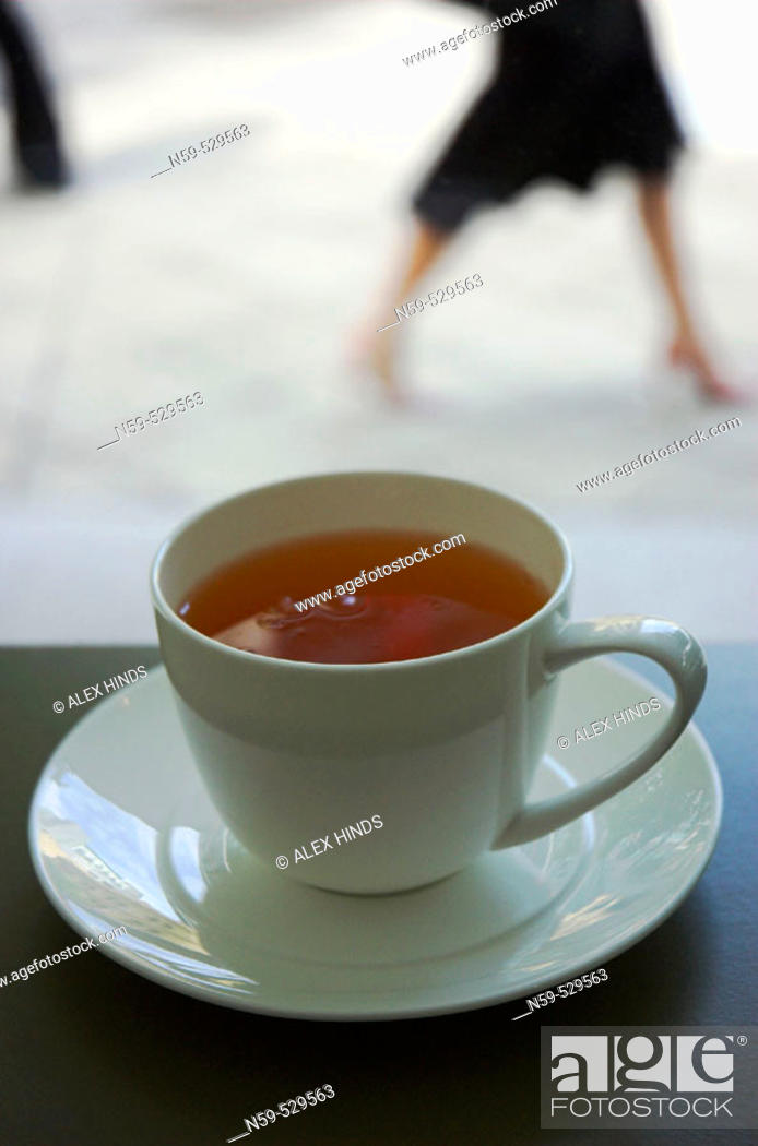 Stock Photo: Street scene viewed over a cup of tea in a cafe.