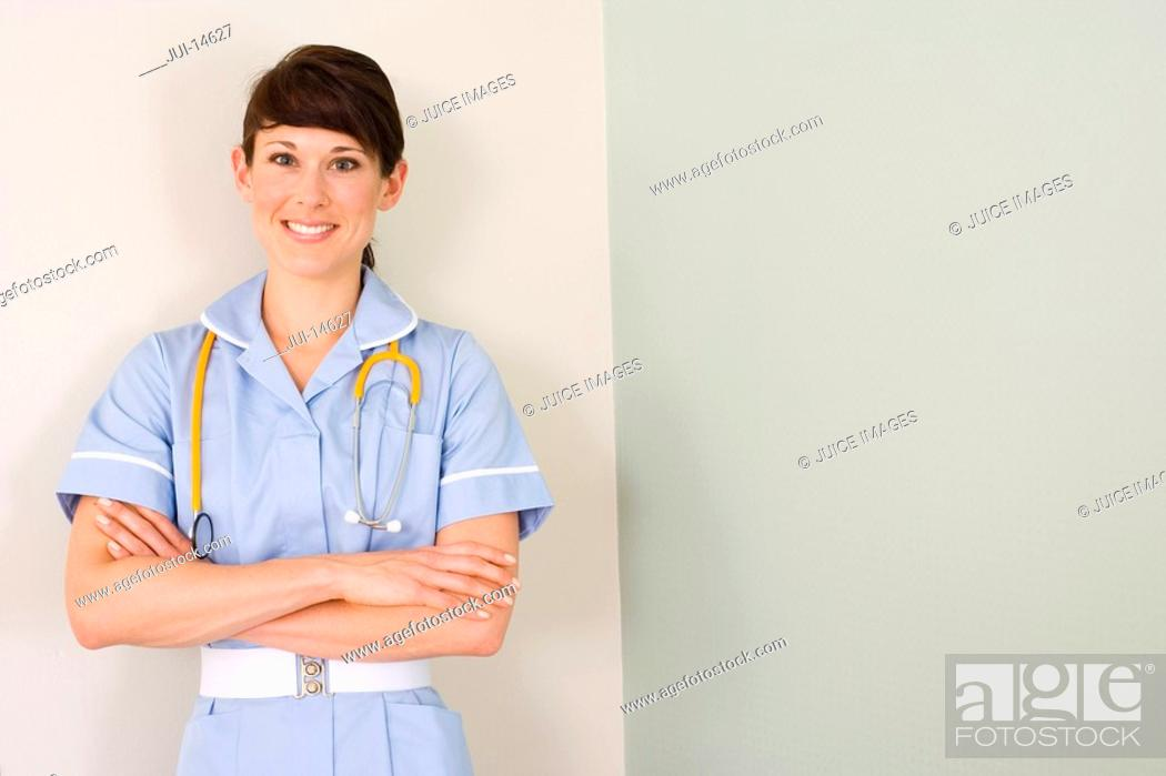 Stock Photo: Nurse with arms crossed, stethoscope around neck, smiling, portrait.
