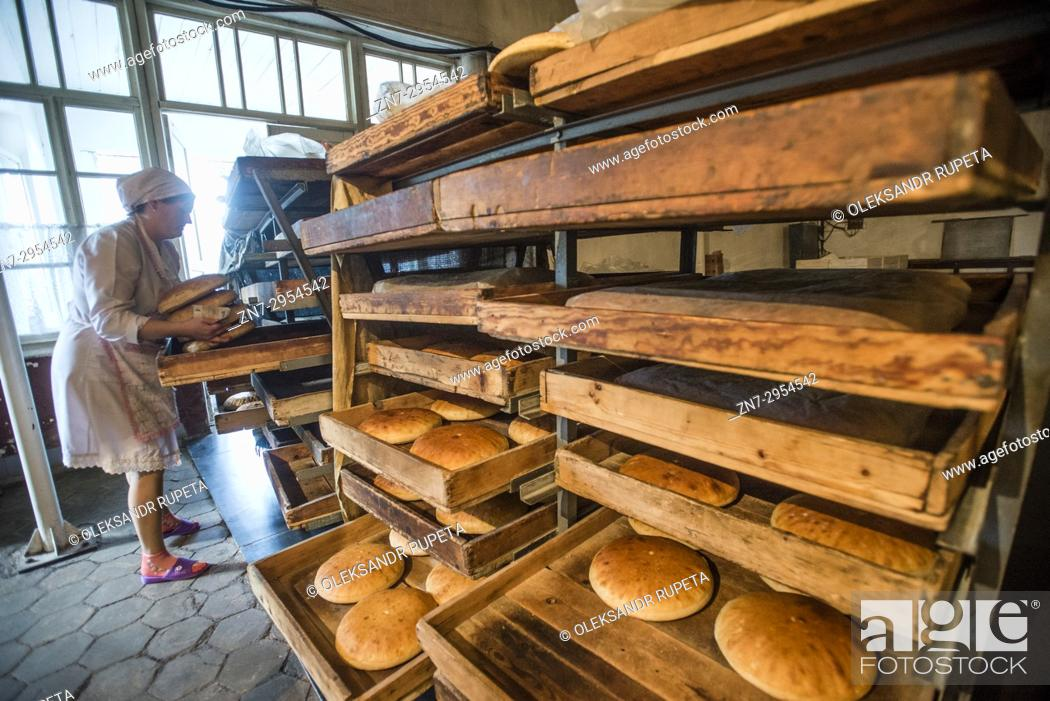 Stock Photo: Workers of the Nikitin Kolkhoz bakery prepare bread, Ivanovka village, Azerbaijan. Bakery makes bread for local people. Children from school and kindergarden of.