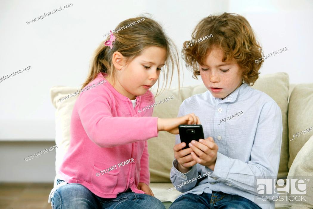 Stock Photo: Children using smartphone.