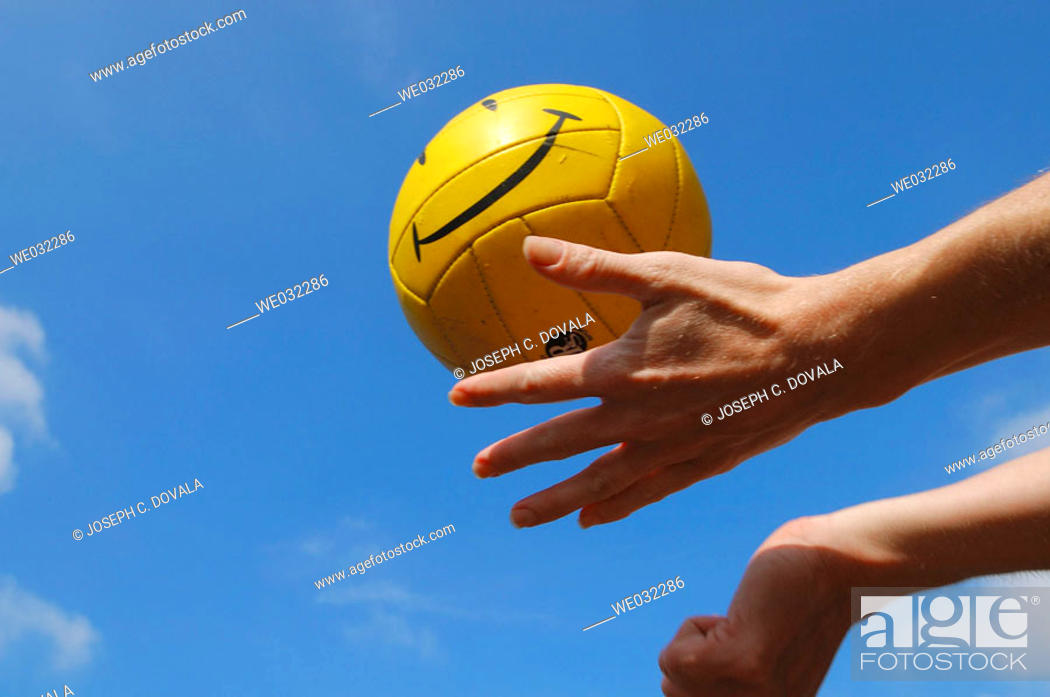 Stock Photo: Person serving smily face volleyball.