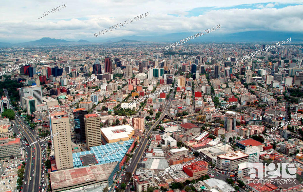 Stock Photo: Mexico City as seen from the heliport at the top of Petróleos Mexicanos headquarters tower, Mexico City. Mexico D.F., Mexico.