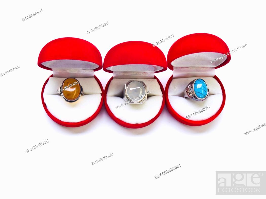 Stock Photo: Opened round red jewelry boxes isolated on white background.