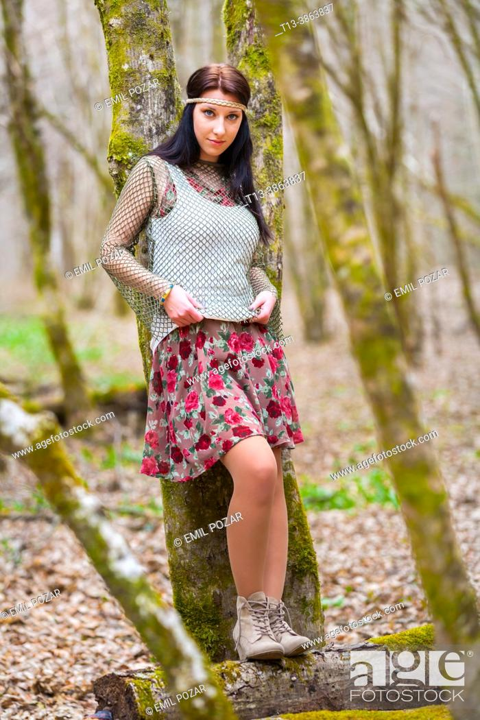 Stock Photo: Country-girl is standing inclined on a tree in a Autumnal forest.